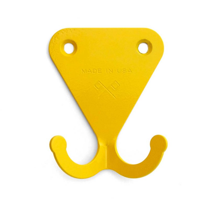 bold yellow steel wall hook with two prongs
