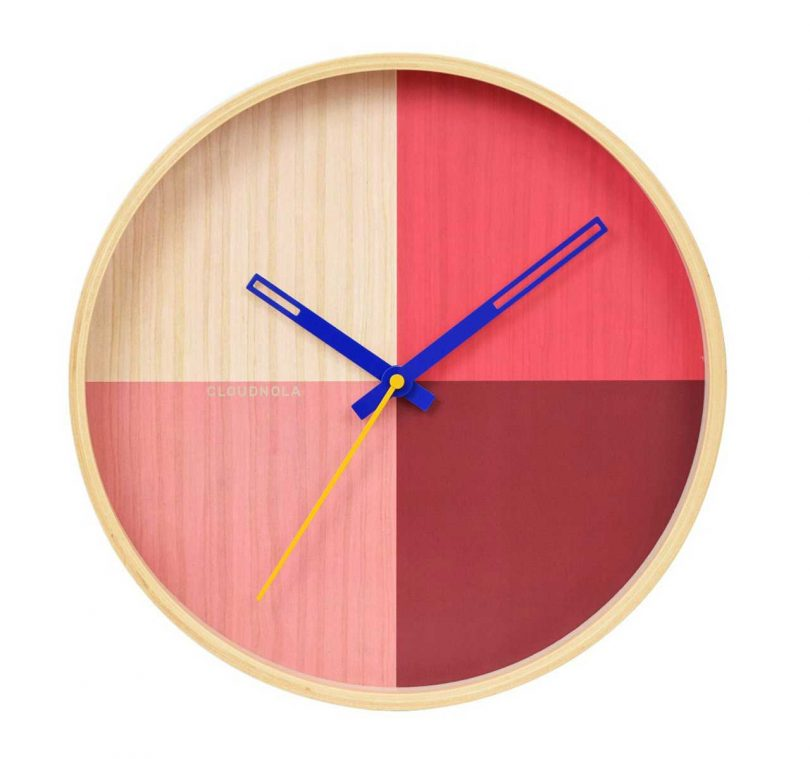 wooden wall clock with face in pink hues