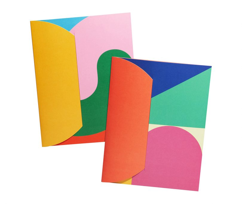 two folders with a colorful geometric pattern design on white background