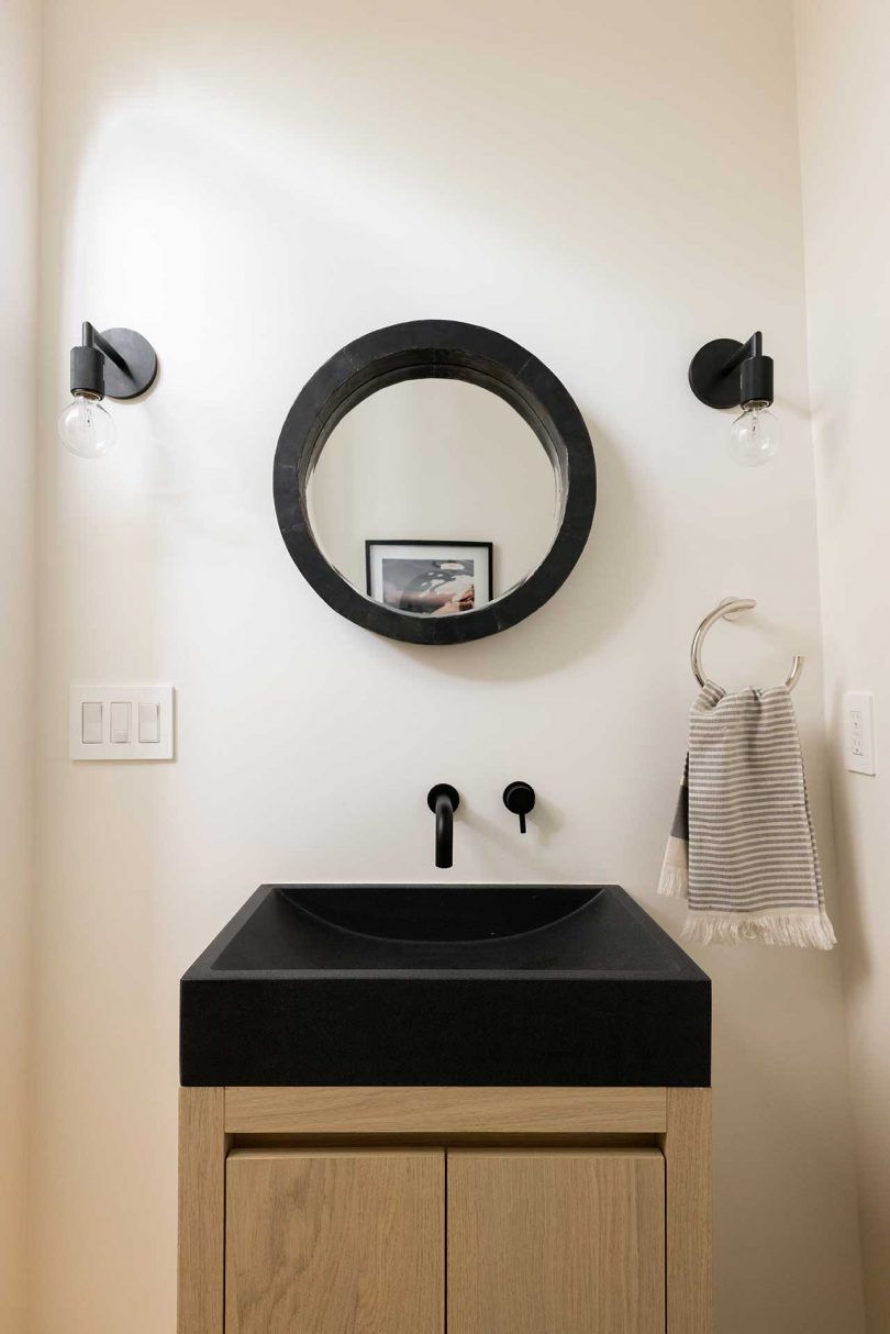 bathroom with black sink and fixtures