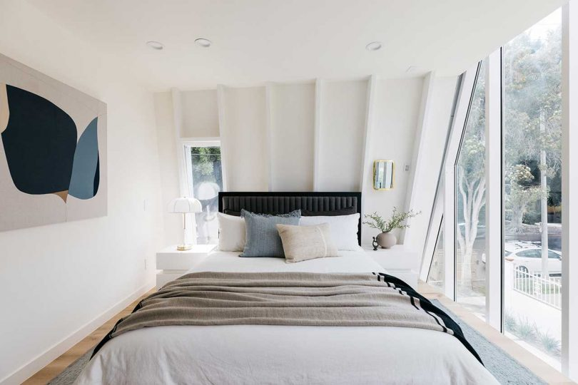 compact modern bedroom with curved walls
