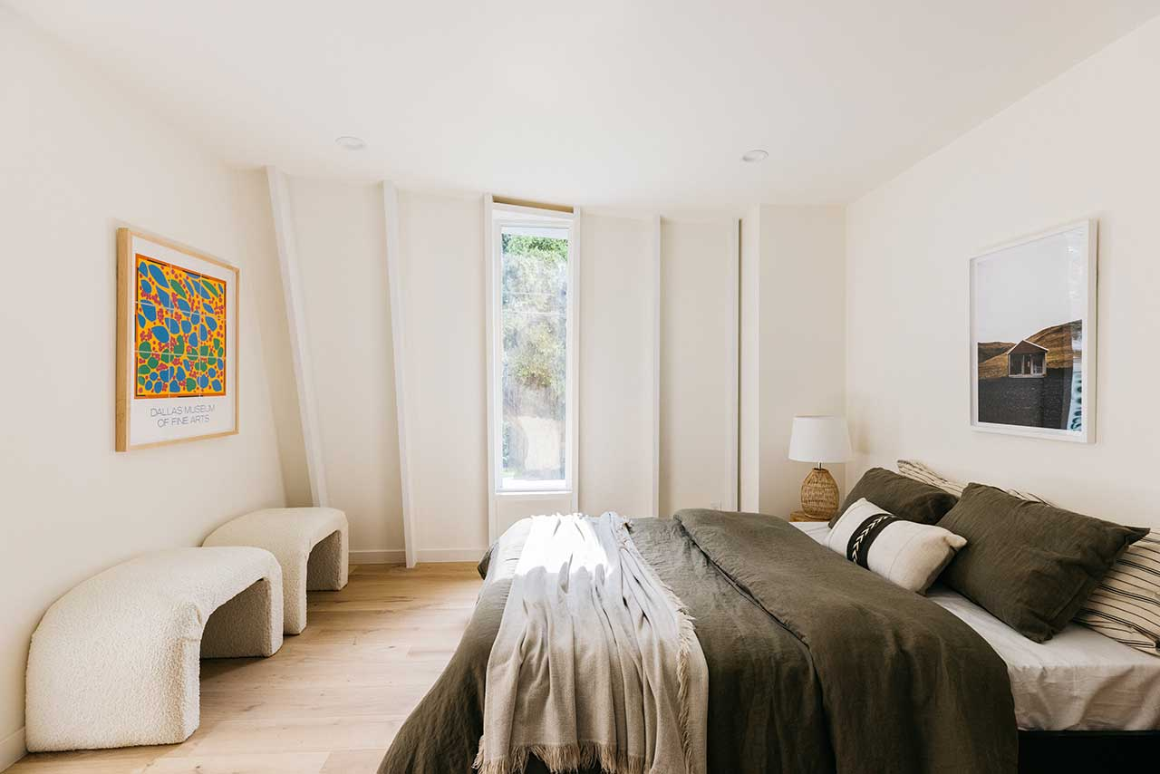 modern bedroom with curved wall and window