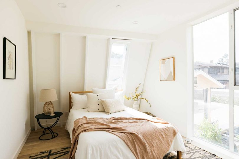 modern white bedroom with curved walls