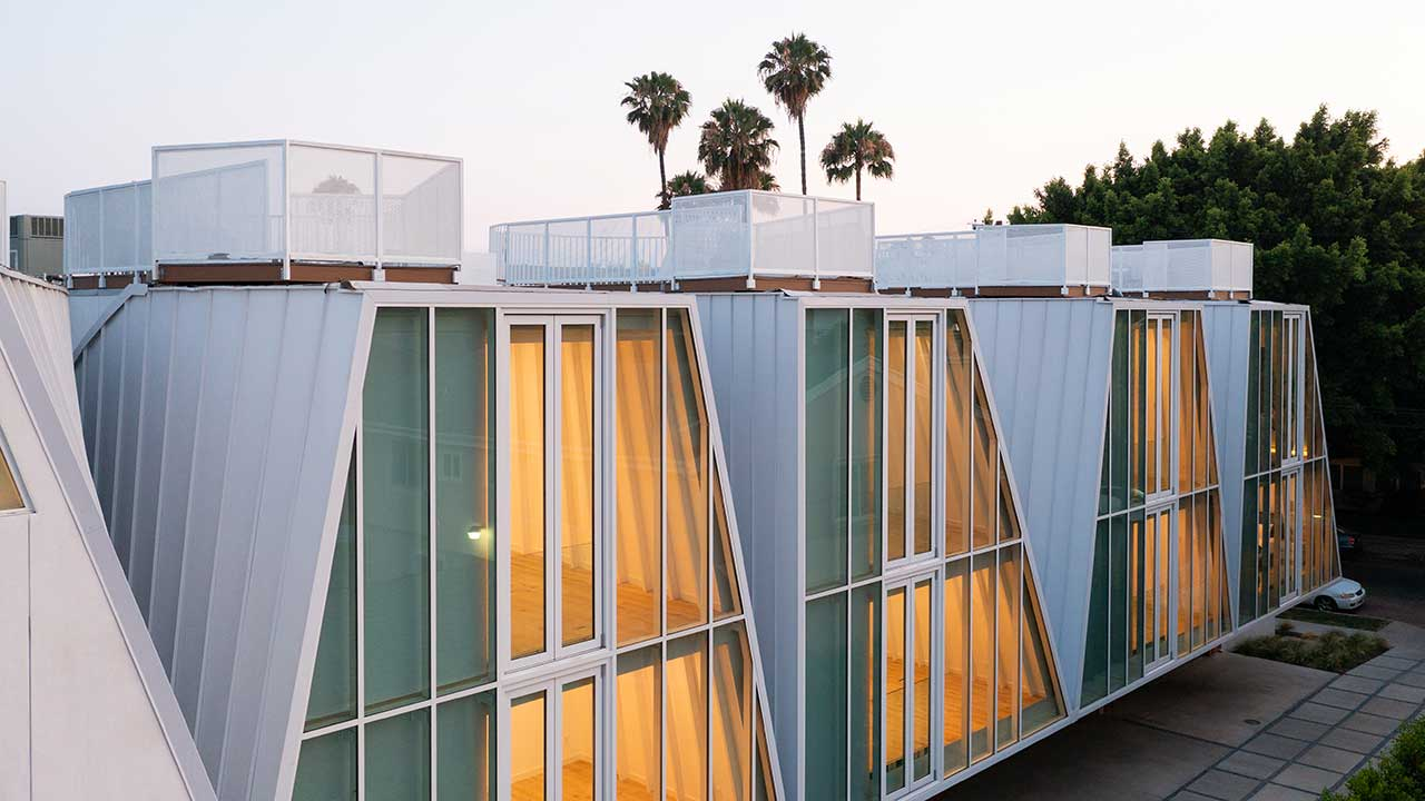 Exterior of 5 modern houses with glass fronts