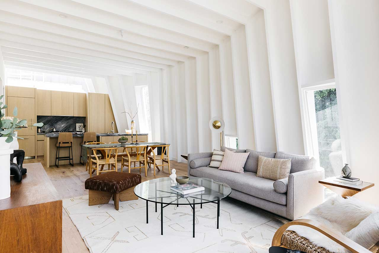 modern white interior living space with curved walls