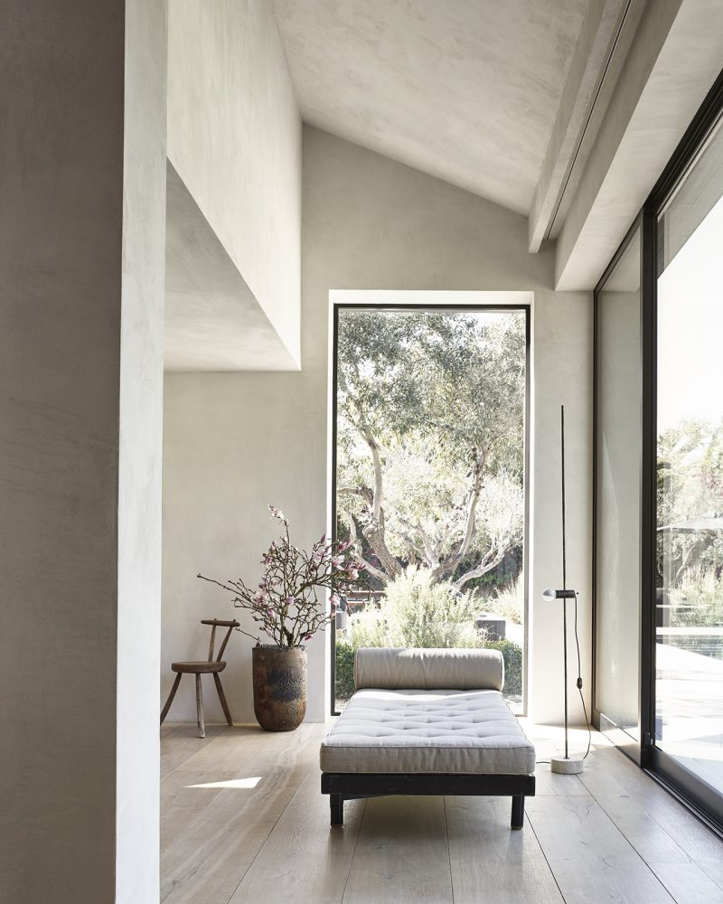 living space with daybed and large windows