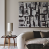 living space with sofa, side table, coffee table, and black and white art