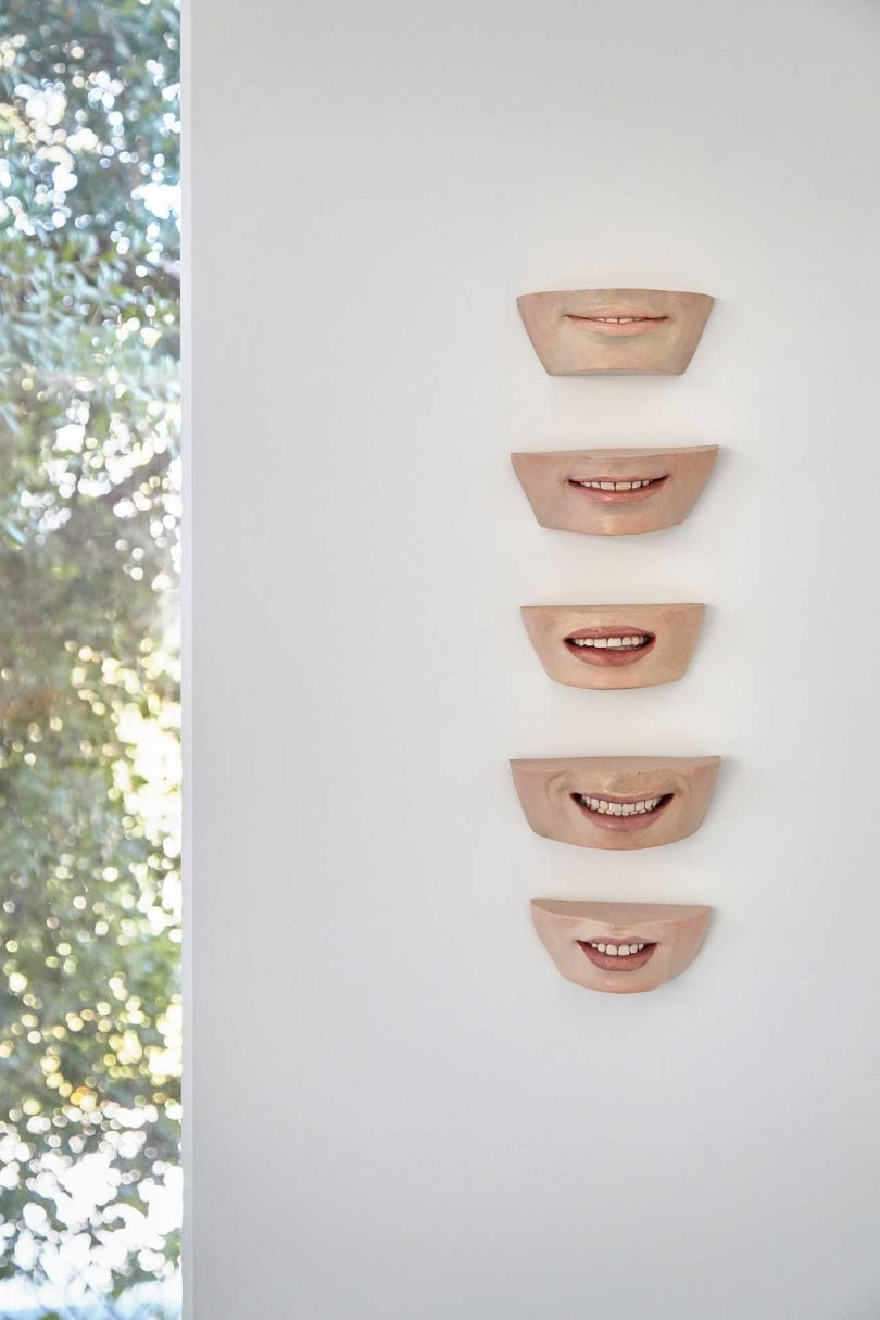 wall art of lower half of five people's faces