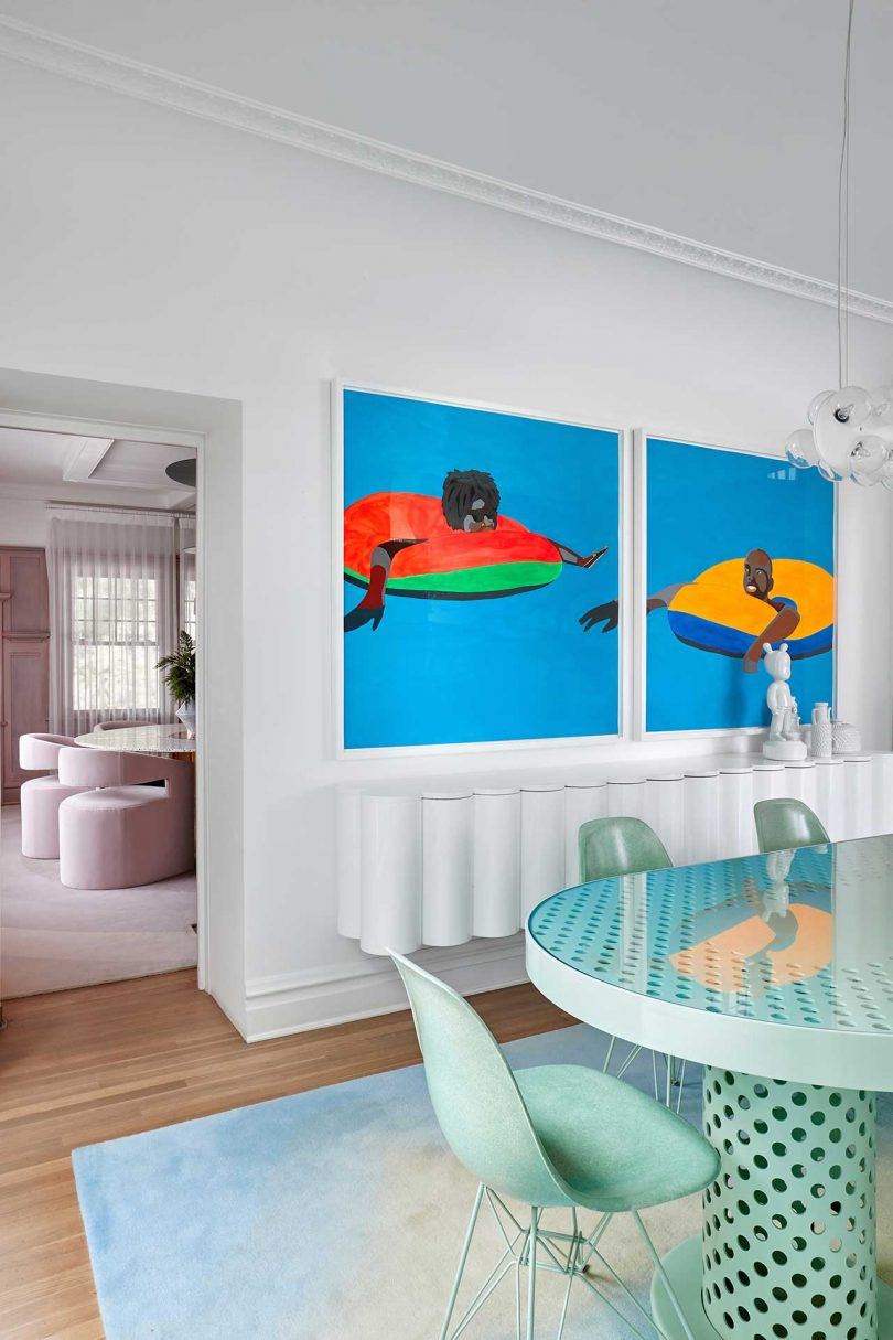 eating area with pale green furnishings and bold art
