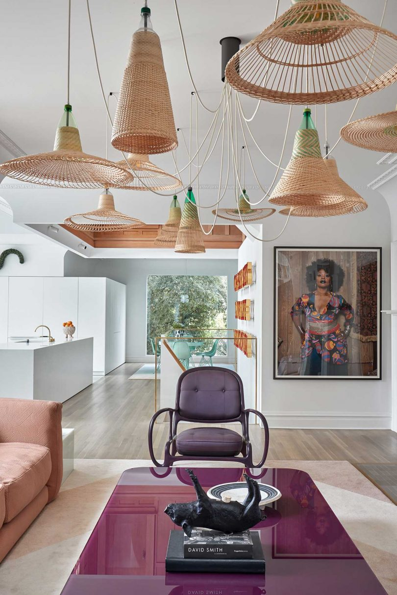 seating area with purple chair and woven pendants