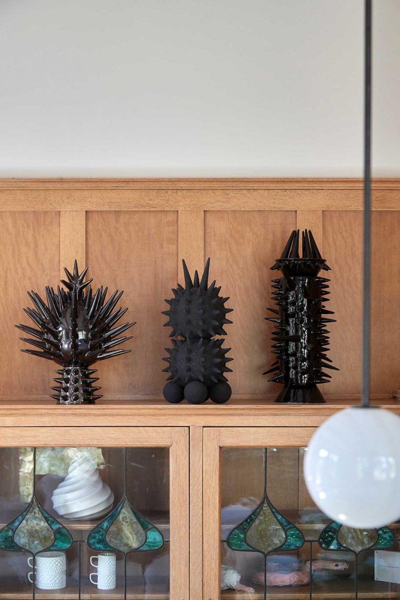 modern black sculptures on shelf