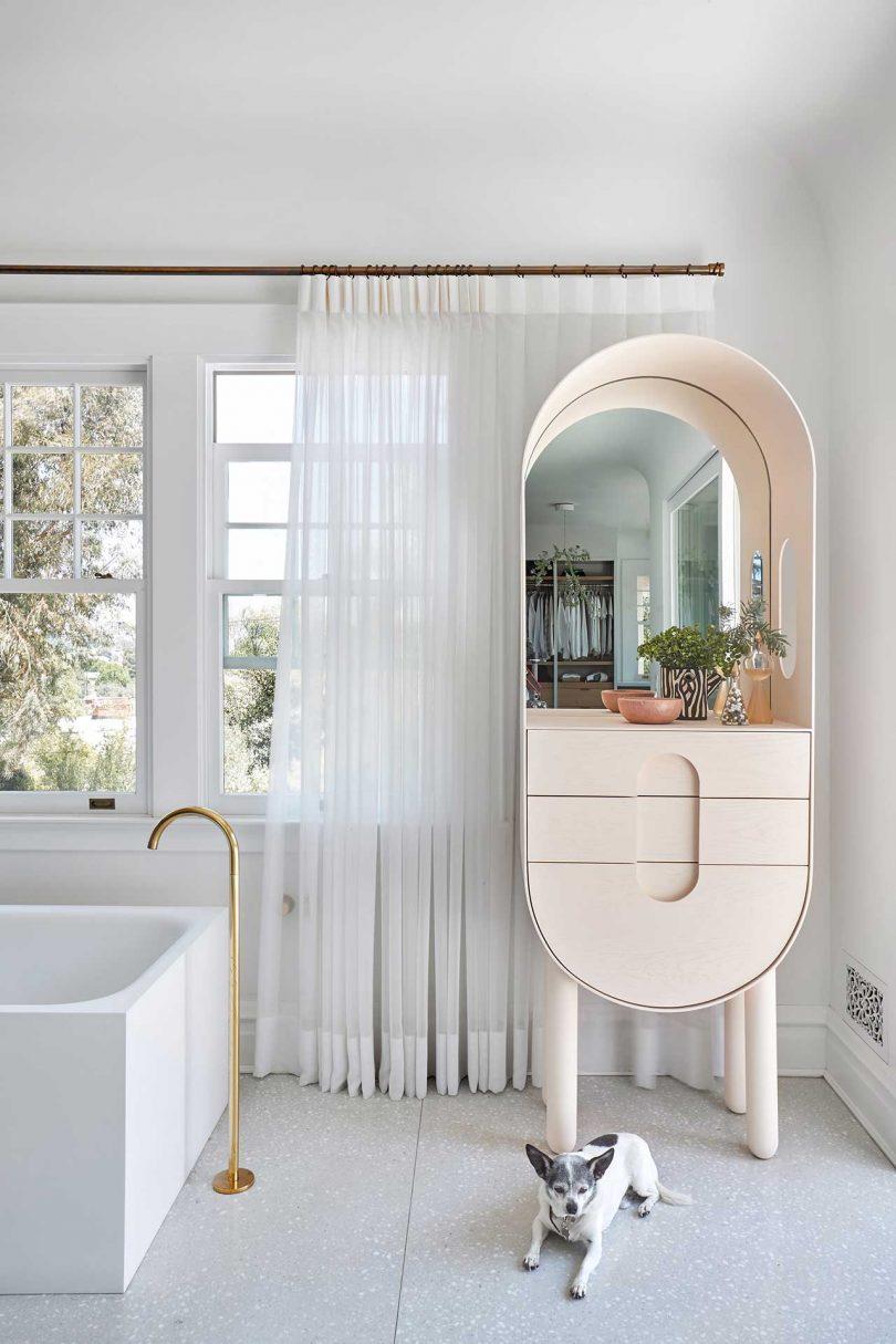 bathroom with modern oval shelf