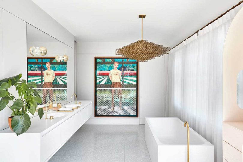 main bathroom with white vanity and tub