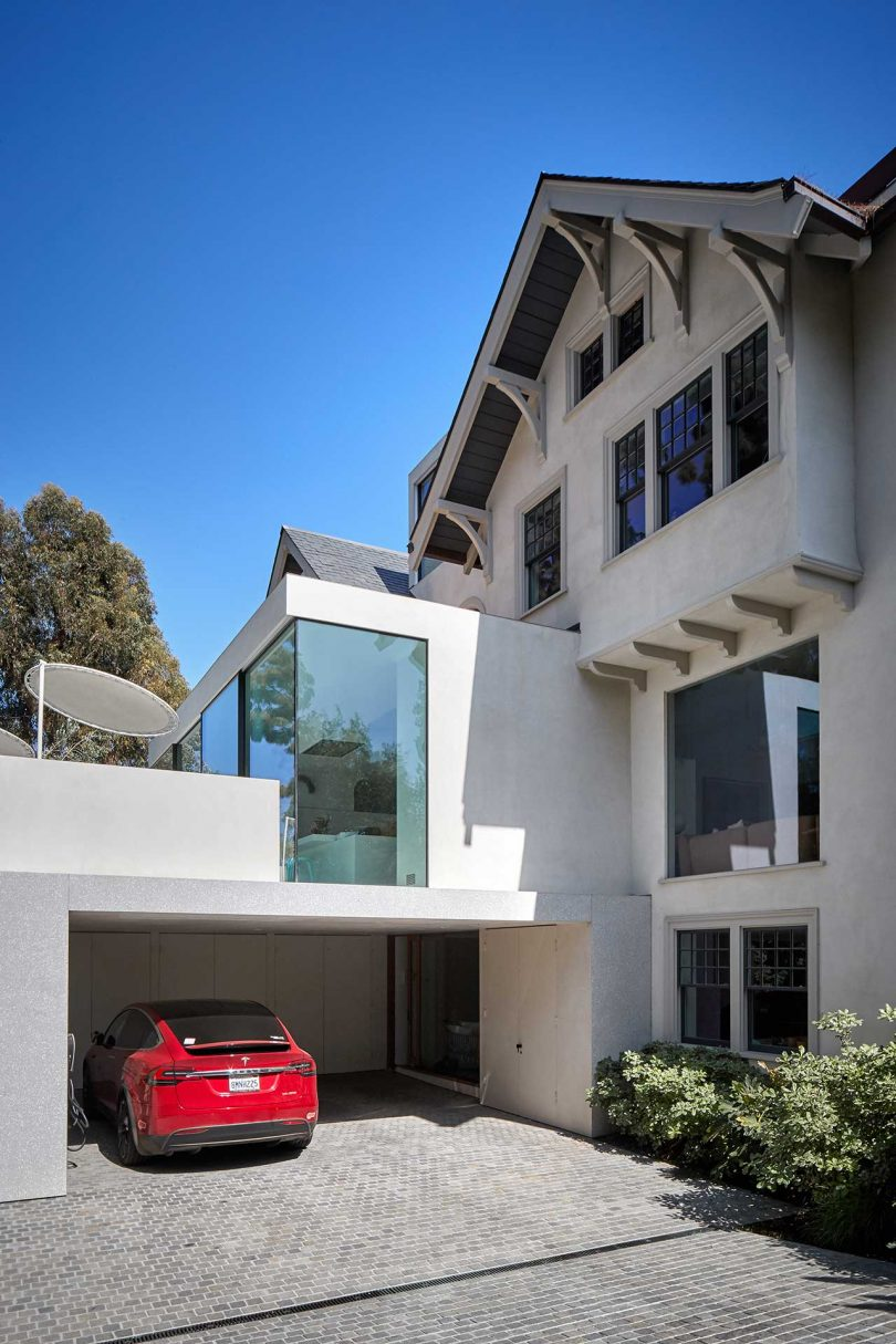exterior of spanish colonial estate with modern glass addition