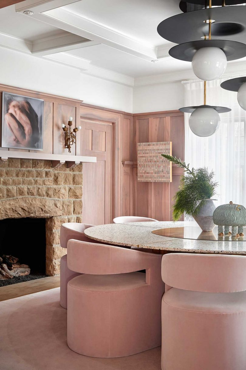 dining room with pink velvet chairs
