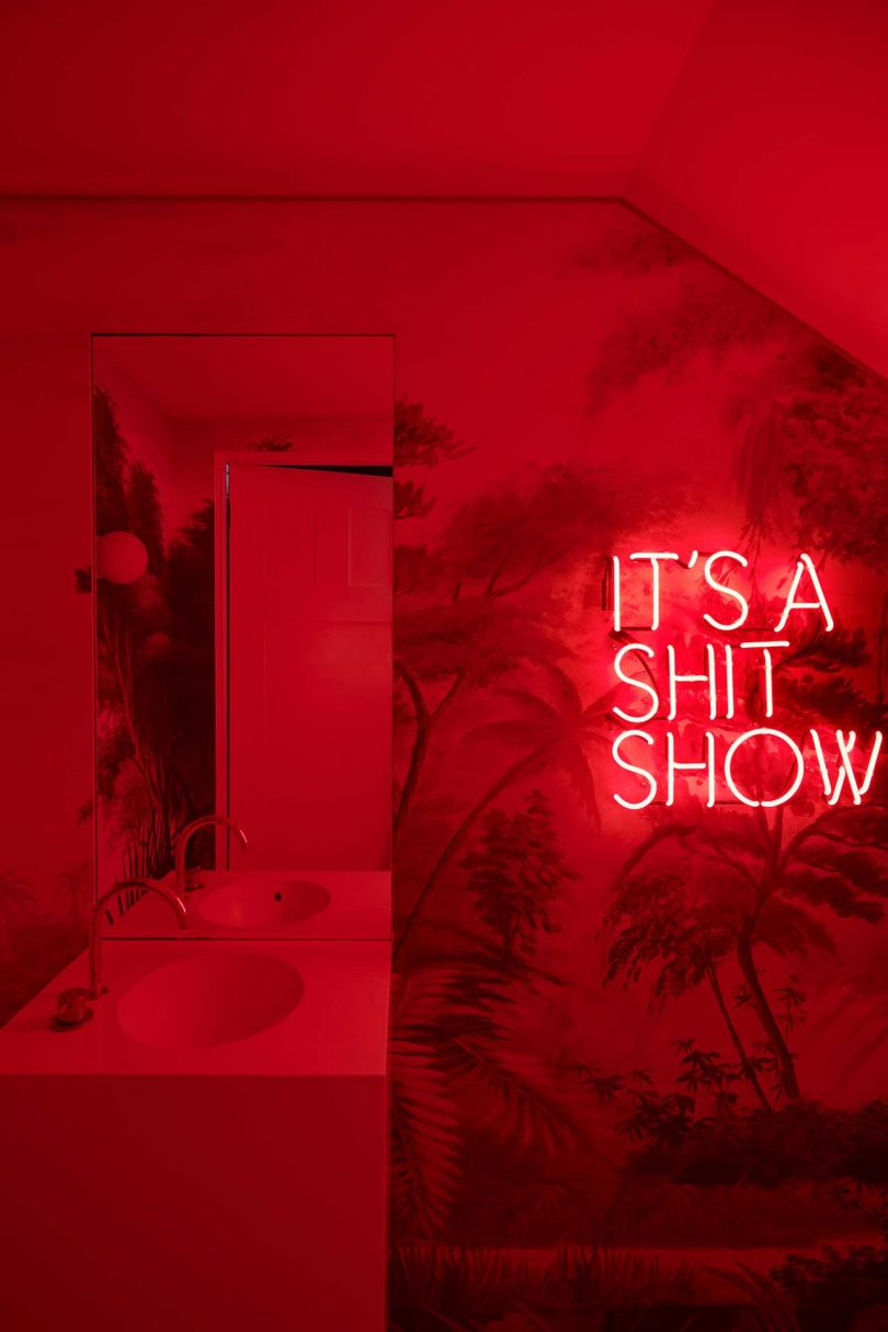 red bathroom with neon light