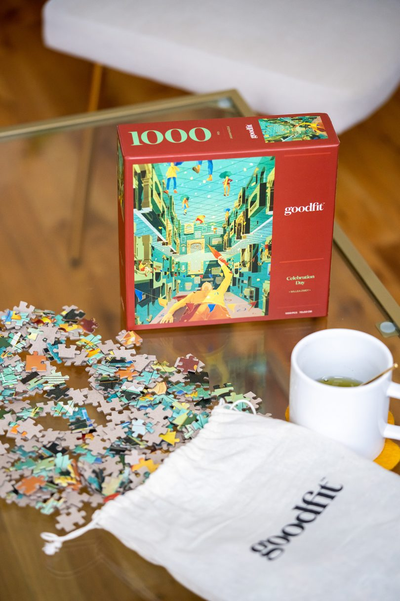 puzzle box with pieces and coffee mug on wood surface