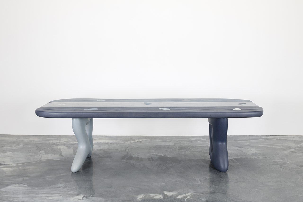 abstract table on concrete floor in front of white wall