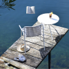 white armchair and bistro table on dock