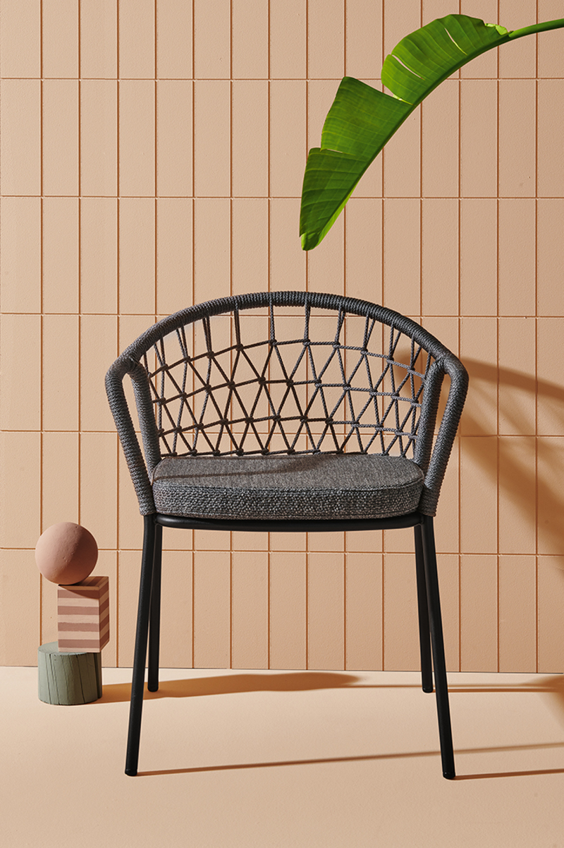 grey armchair against peach wall