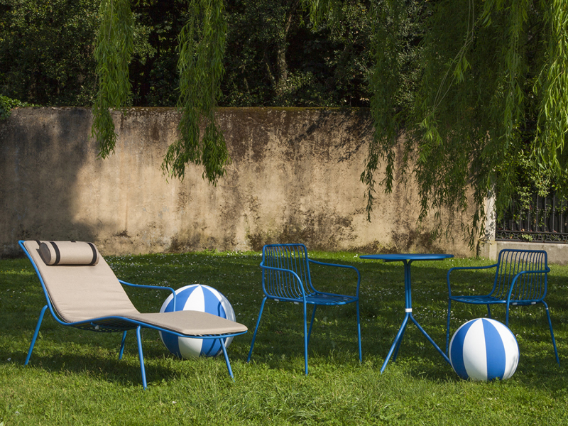 lounge chair and blue bistro set outside