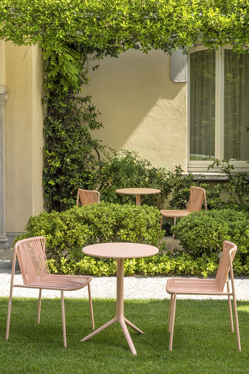 two coral bistro sets outdoors