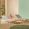 two white chaise lounges