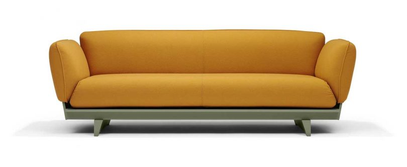 FLOAT SOFA in ocre fabric with green base