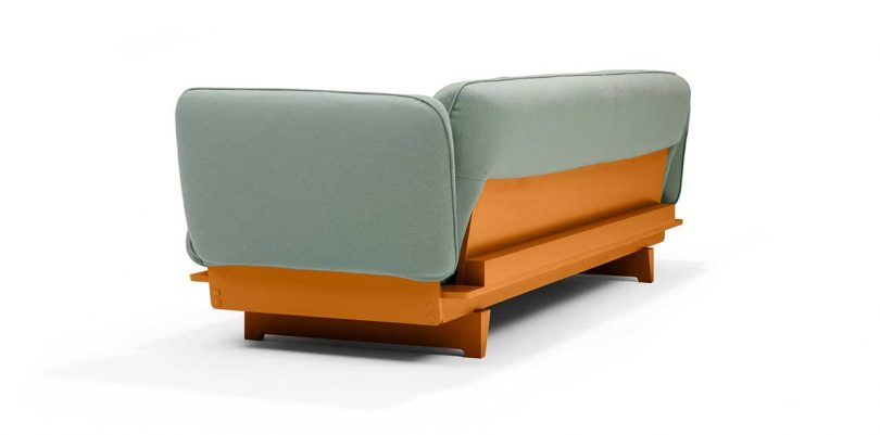 FLOAT SOFA in green fabric with ocre base