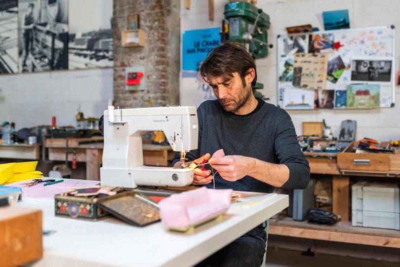 designer at a sewing machine