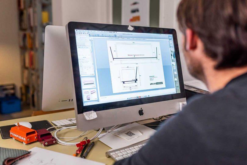 Designer at computer making drawings