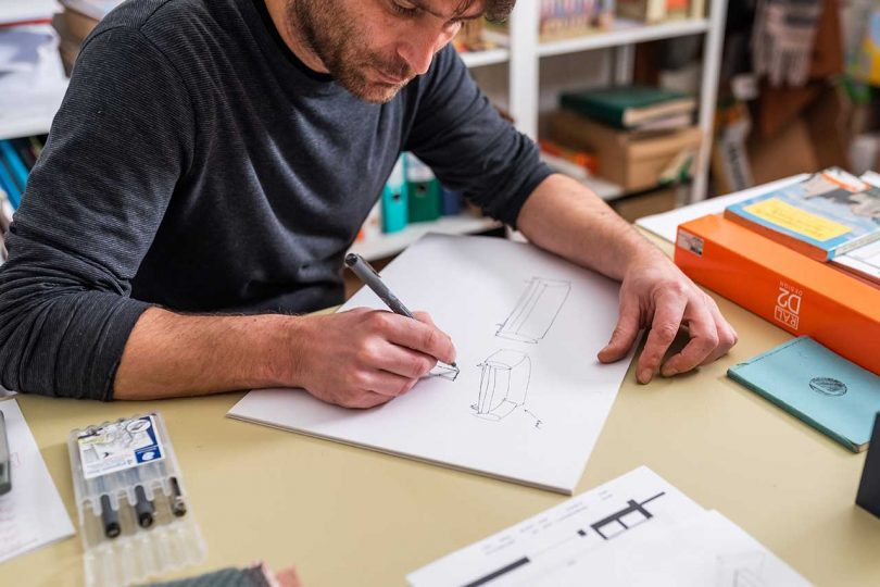 Designer sketching prototype drawings
