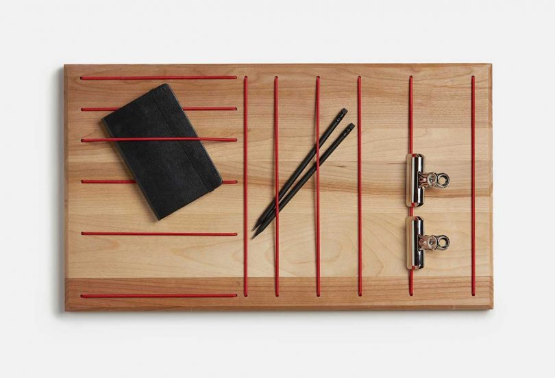 wood wall organizer with red elastic holders