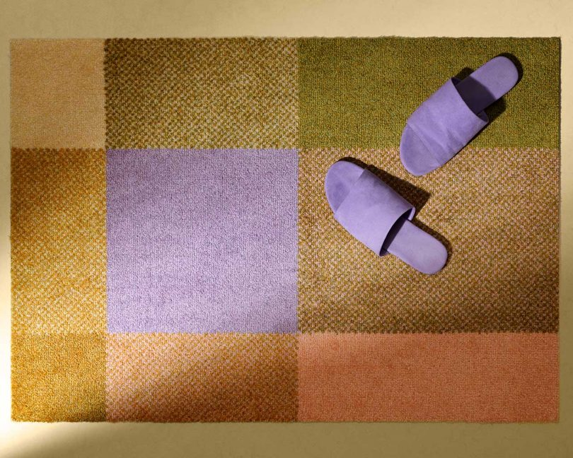 vibrant rug in shades of green, pink and lavendar