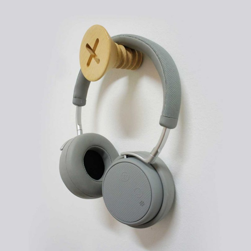 oversized screw wall hanger with headphones
