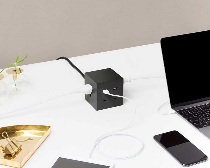 desk with tech devices and charging hub