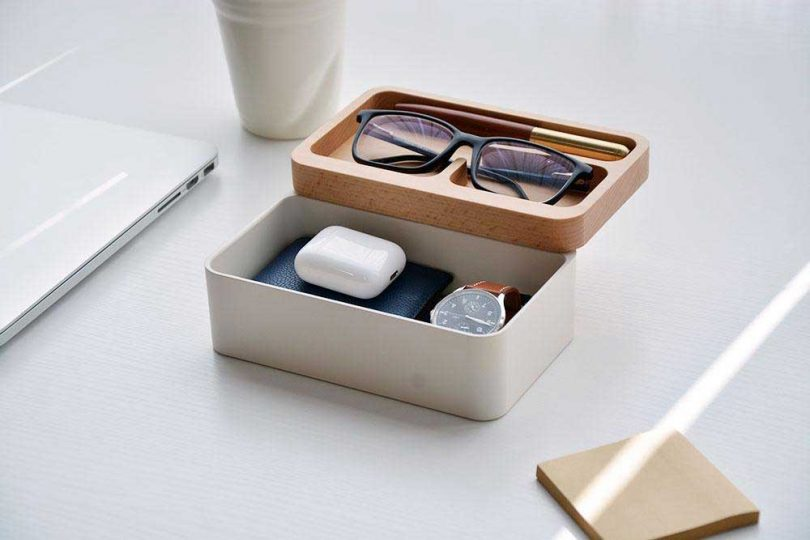 box with rotating wooden lid holding glasses, a watch and AirPods