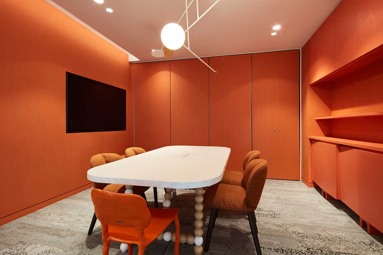 modern office with orange conference room