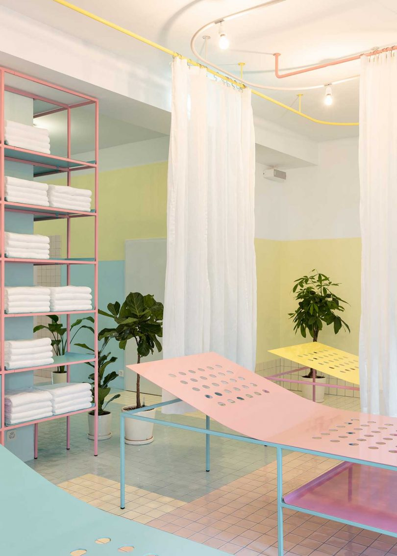 pastel tiled treatment room with beds and plants