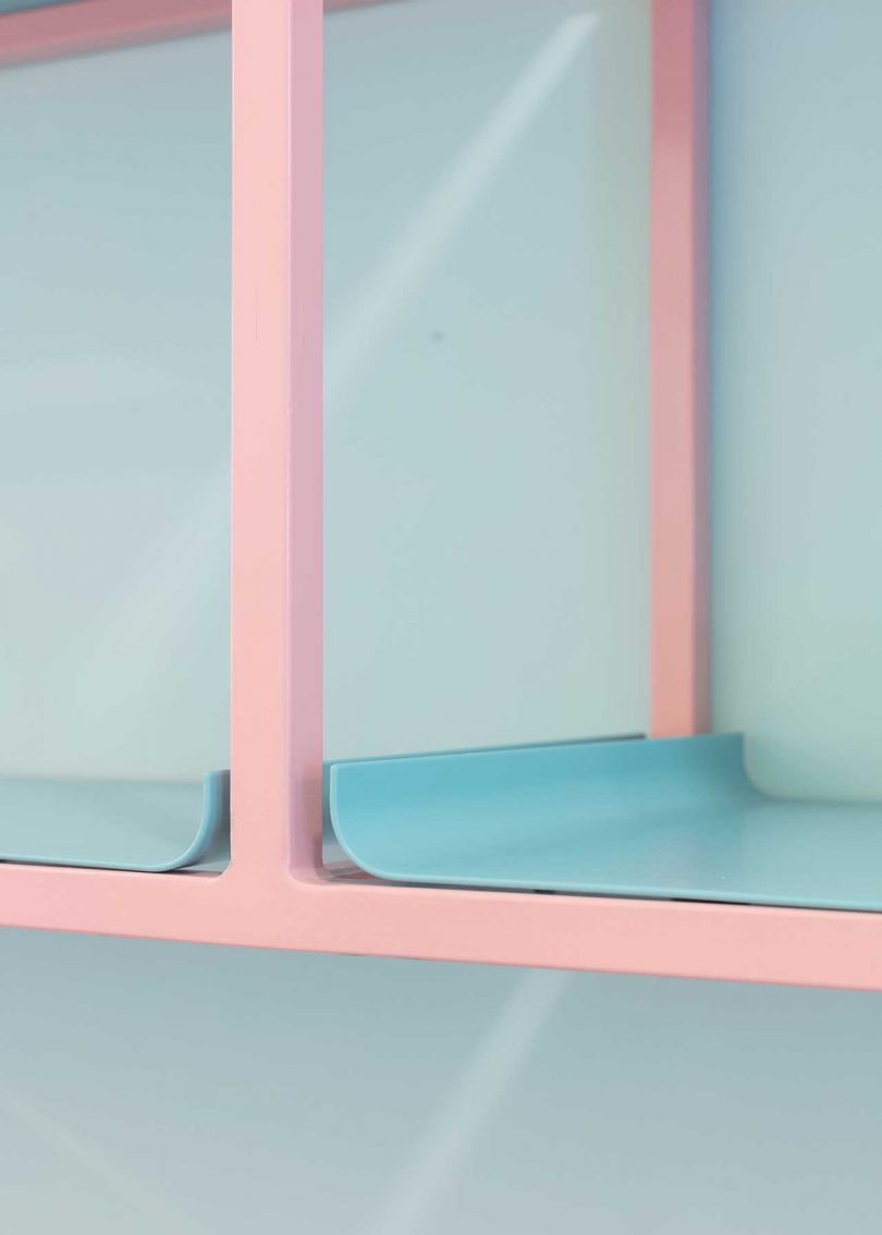 closeup of pink and blue shelving