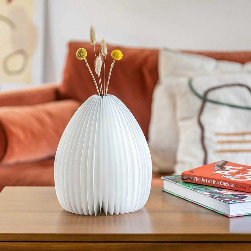 Light unlit with vase holding flowers