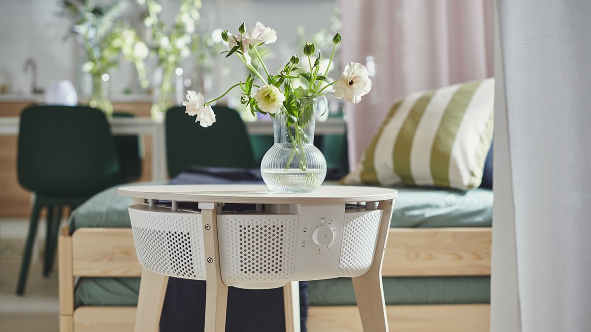 IKEA side table air purifier with flowers in vase