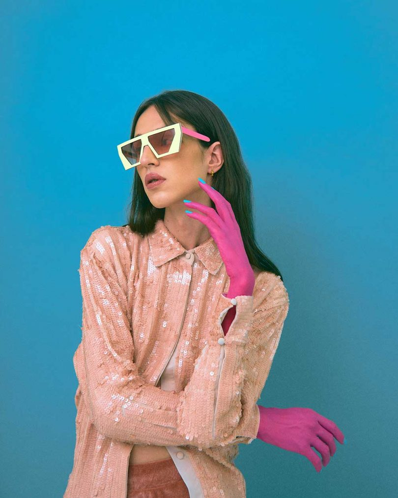 girl wearing yellow and pink sunglasses
