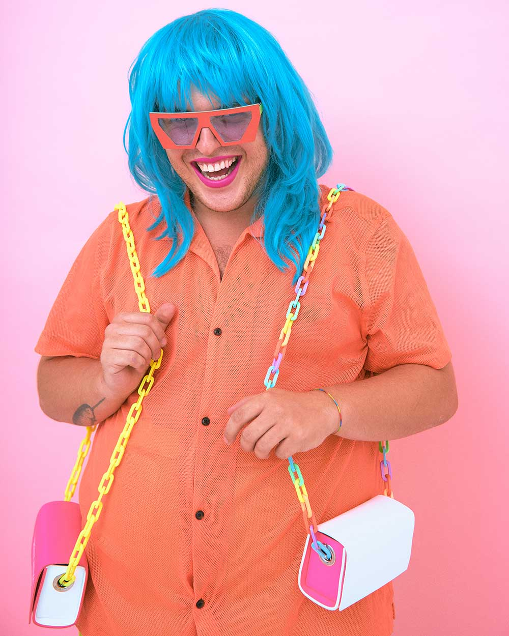 person wearing blue wig and orange sunglasses