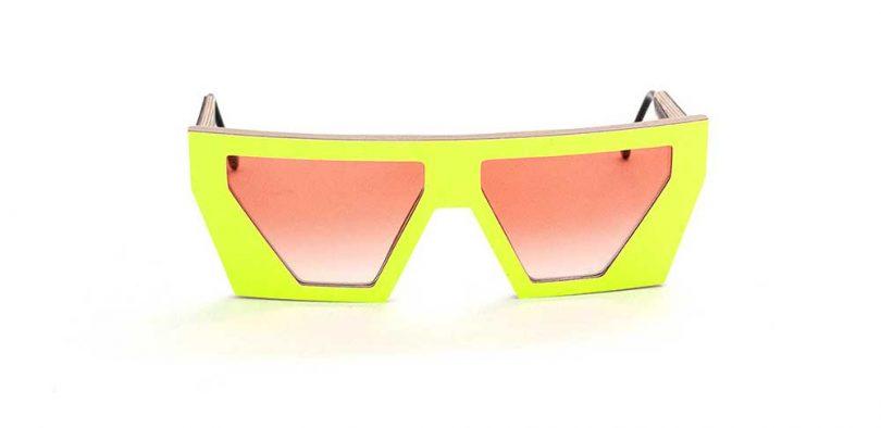 neon yellow sunglasses on white backdrop