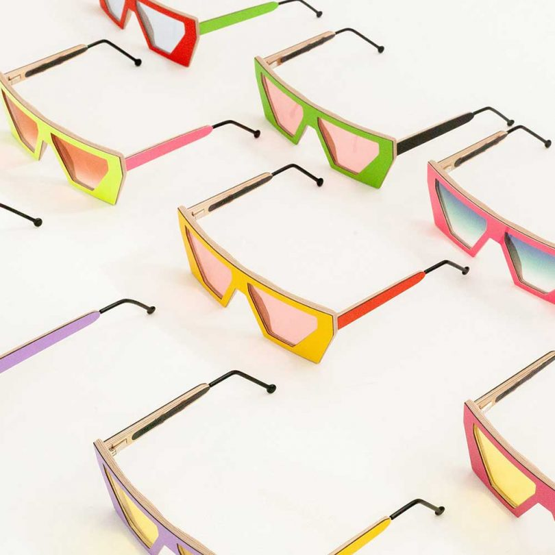 multiple colorful sunglasses on white