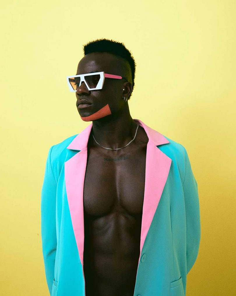 man in neon jacket with colorful sunglasses