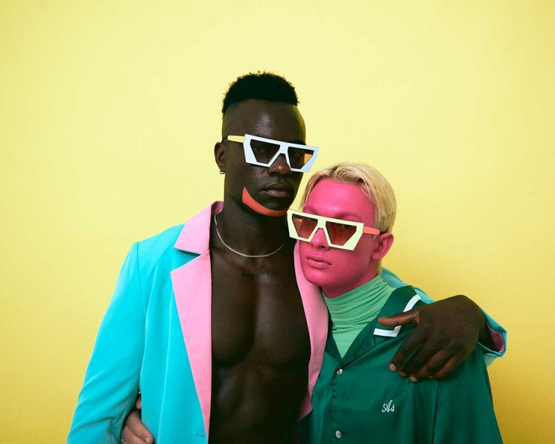 men wearing colorful clothing in neon sunglasses