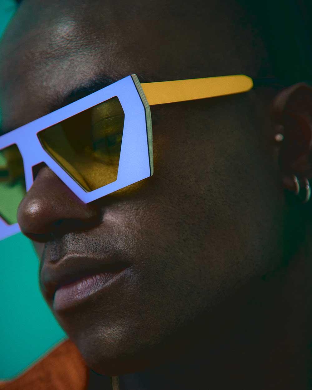 man in purple and orange sunglasses