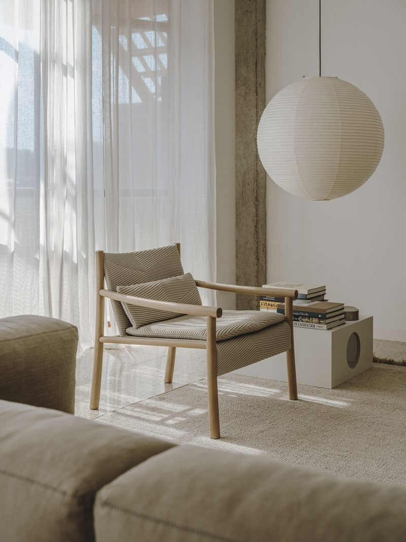 light colored armchair in living space